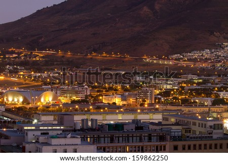 Night shot of Cape Town towards Table Mountain showing many building with night lights