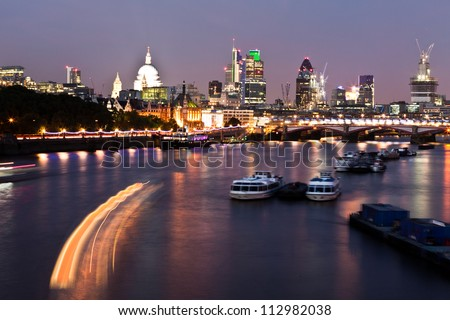 Night shot of London cityscape from Waterloo Bridge - stock photo