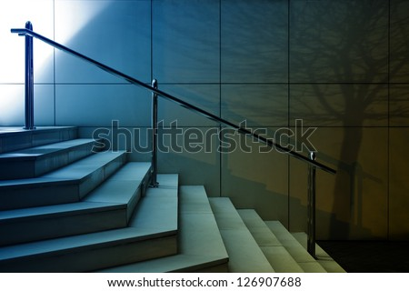 Night shot of modern stairs on building entrance with tree shadow on the wall - stock photo