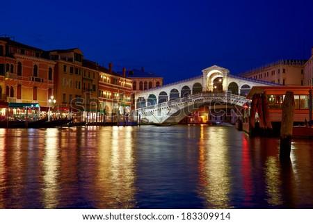 Night shot of Rialto Bridge ( Ponte Rialto ) on Canal Grande in Venice, Veneto, Italy - stock photo