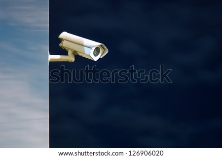 Night shot of security or CCTV camera on the modern building