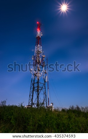 Night shot of the antenna tower on the top of the hill