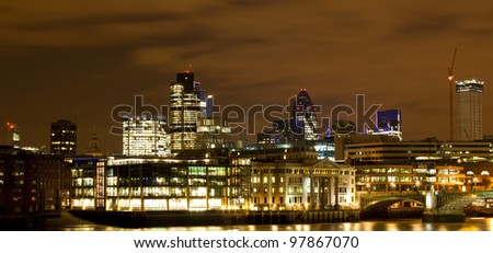 Night shot of the City of London with landmark buildings clearly visible - stock photo