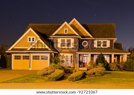 Night shot of the house at sunrise-sunset. - stock photo