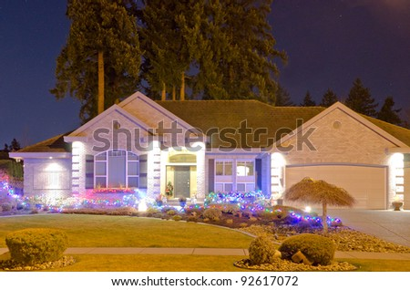 Night shot of the house with lights on.