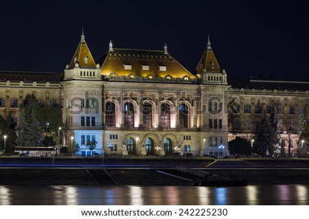 Night shot of the illuminated University of Technology and Economics in Budapest, Hungary - stock photo