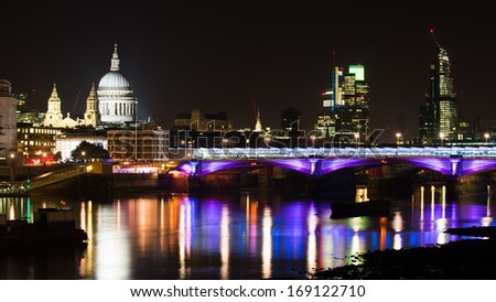 Night shot of the over the river Thames in London, capital of UK, leading to saint Paul's cathedral,  London, December, 2013.  - stock photo