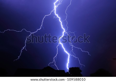 Night shot with big thunderstorm at the starry sky. - stock photo