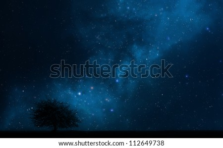 Night sky abstract space background with lonely tree - stock photo