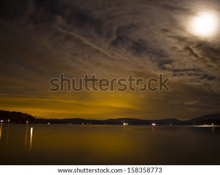 Night sky over lake in New England