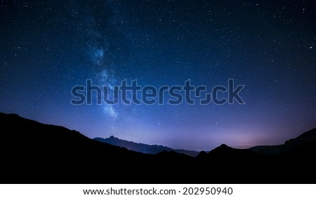 night sky stars with milky way on mountain background - stock photo