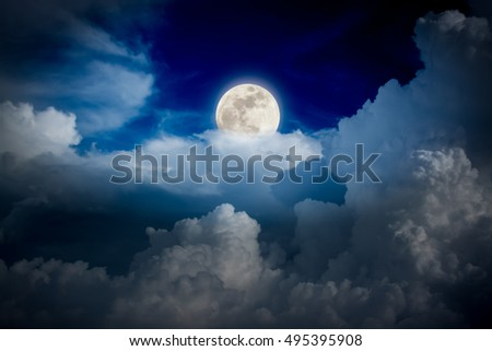 Night sky with full moon above colud
