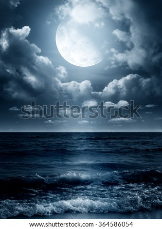 Night sky with full moon and reflection in sea. Elements of this image furnished by NASA - stock photo