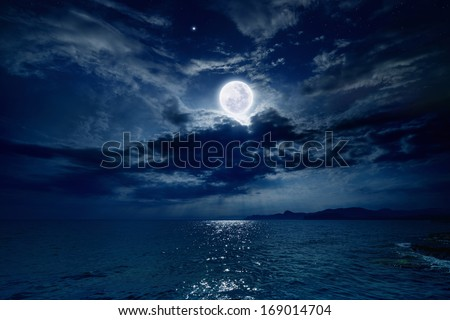 Night sky with full moon and reflection in sea, stars, beautiful clouds. Elements of this image furnished by NASA - stock photo