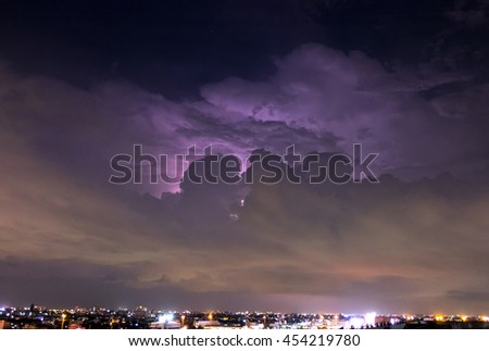 night sky with lightning and storm in city,Bangkok,Thailand.(Selective focus)