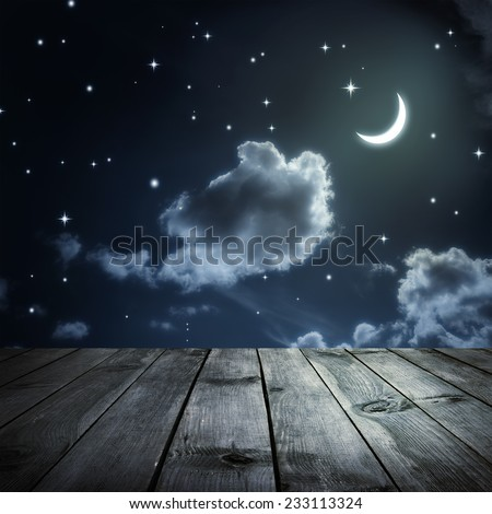 Night sky with stars and moon, wooden planks - stock photo