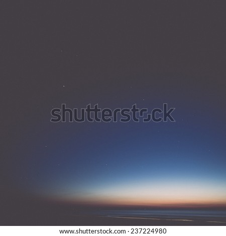 night sky with stars on the summer beach. space view from earth - retro, vintage style look - stock photo