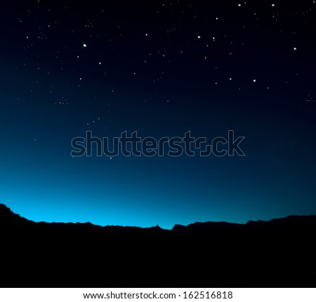 Night sky with starts over mountain - stock photo