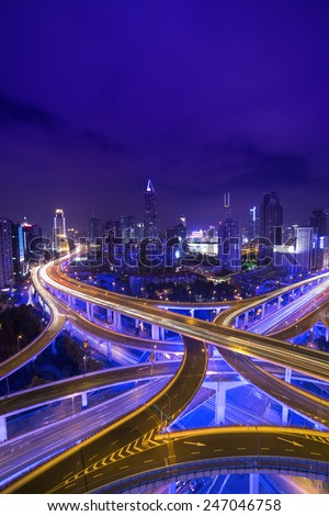 Night skyline view of Shanghai city and highways with flowing traffic - stock photo