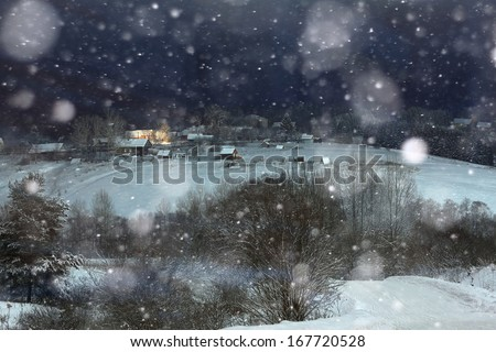Night Snow Village Christmas snowfall - stock photo
