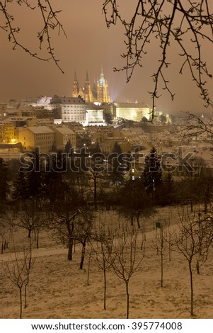 Night snowy foggy Prague City with gothic Castle, Czech republic