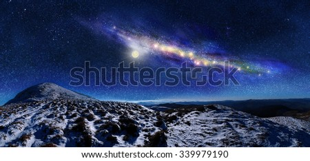 Night space landscape. Milky way galaxy over mountains - stock photo