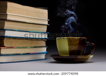 Night stack of books and a cup - stock photo