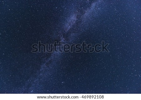 Night starry sky with lot of shiny stars and colorful Milky Way during Perseid meteor shower, natural astro background
