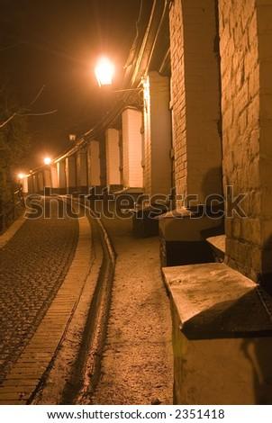 Night street in ancient Kiev near famous Kiev-Pechersk Lavra - stock photo