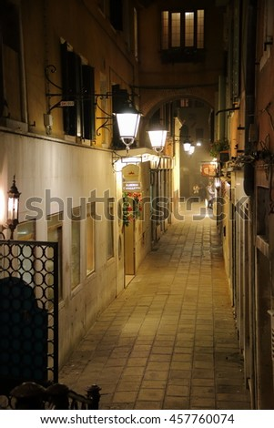 Night street lit lanterns near Hotel Cavalletto and Theater San Gallo. Venice Italy, December 27, 2015