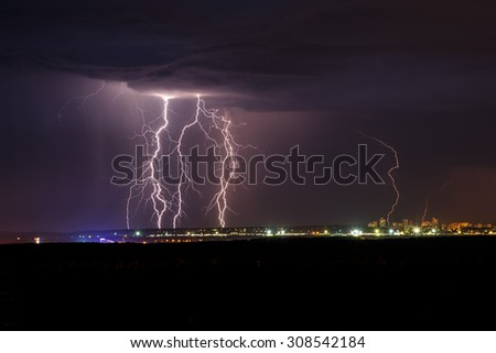Night thunder lightning over the city sky view - stock photo