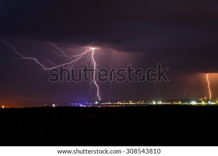 Night thunder lightning over the city sky view - stock photo