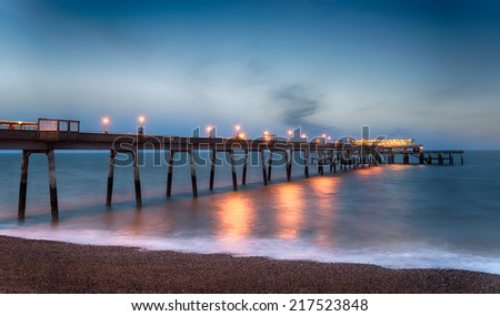 Night time at the pier at Deal in Kent - stock photo
