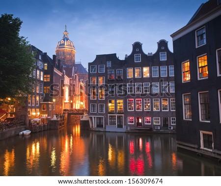 Night time illuminations of the stunning neo-Renaissance St Nicholas Church (1842) in the heart of Amsterdam. - stock photo