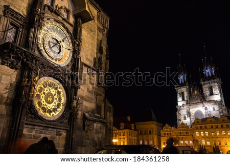 Night time illuminations of the the Old Town Hall (15th Century), Town Square and fairy tale Church of our Lady Tyn (1365) in the Magical city of Prague.  - stock photo