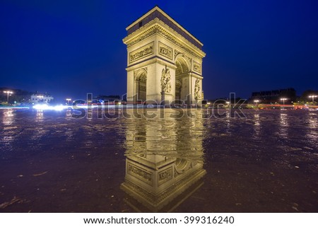 Night time in Arc de Triomphe with pool reflection - stock photo