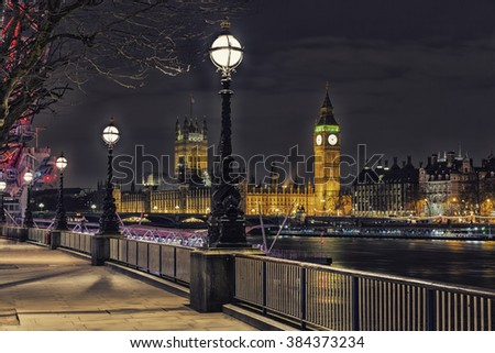 Night time Photo of Street Lamp on South Bank of River Thames with Big Ben and Palace of Westminster in Background, London, England, UK - stock photo