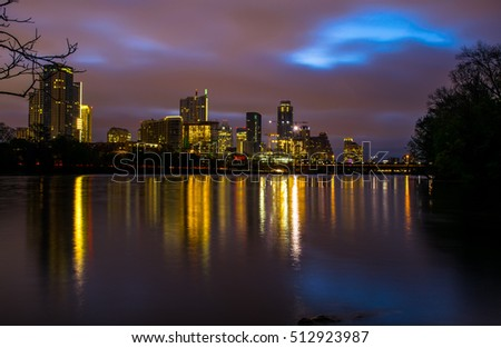 Night Time Skyline Cityscape Reflections along water Austin Texas capital