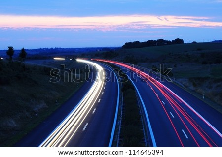 night time traffic on highway with lights showing transportation concept - stock photo