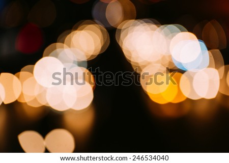 Night time View of Defocused Lights of Traffic on a Busy City Road - stock photo