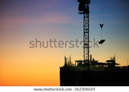 Night time view of high building construction site, Bangkok Thailand - stock photo