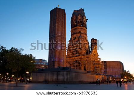 Night time view of illuminated Kaiser-Wilhelm Memorial Church in Berlin, Germany - stock photo
