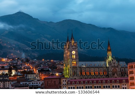 Night time view of the basilica and old town in Quito, Ecuador - stock photo