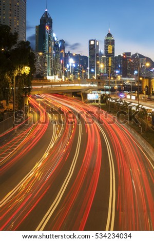 Night traffic and skyline of Hong Kong city at dusk