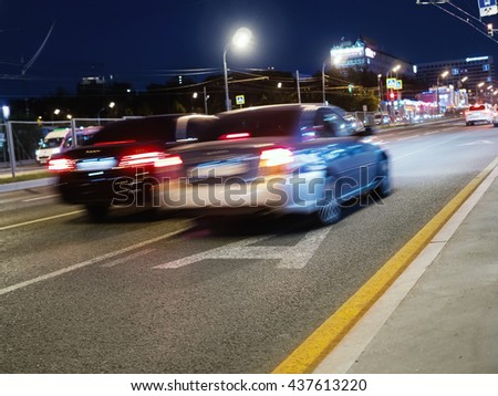 Night traffic - Blurred motion in the big city. Shallow depth of field. - stock photo