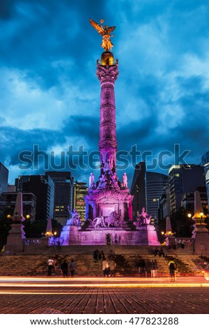 Night traffic drives past the Angel of Independence in Mexico City, Mexico.