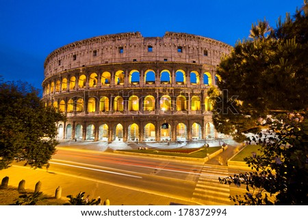 Night traffic in front of an Amphitheater, Colosseum, Rome, Lazio, Italy