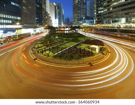 Night Traffic in Hong Kong city at dusk - stock photo