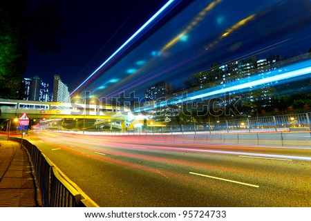 night traffic light trail in city - stock photo