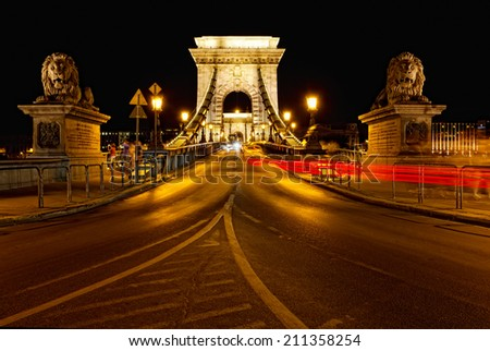 Night traffic of cars on Secheni Bridge through Danube in Budapest - stock photo